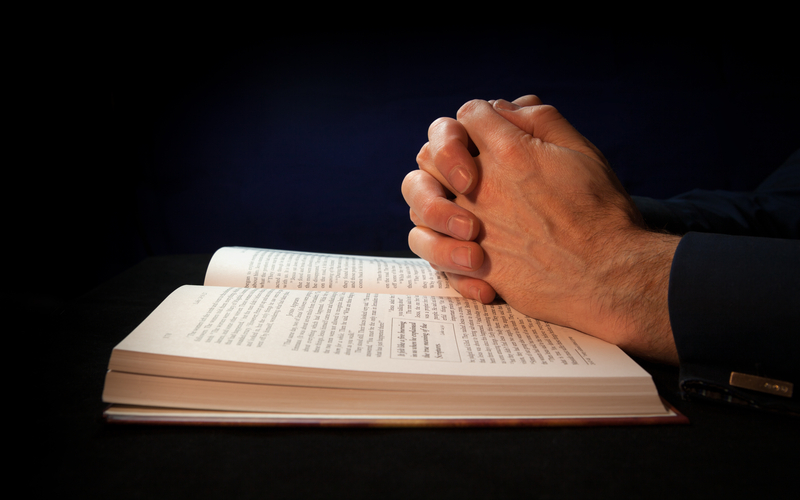 © Duncanandison | Dreamstime.com - Clasped Hands On A Bible Photo